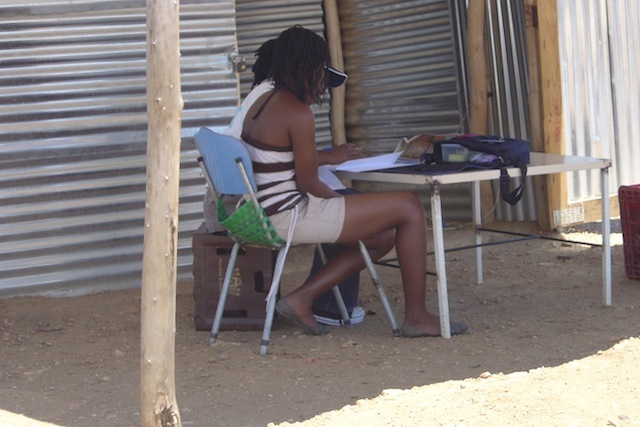 A CIET fieldworker interviews a woman as part of the 2008 baseline survey in Namibia